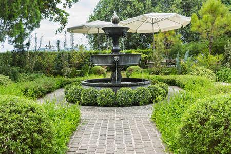 Fountain In English Garden Design. Stock Photo   45899512