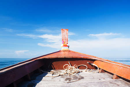 long tailed boat: Head of wooden long tailed boat with sea and sky