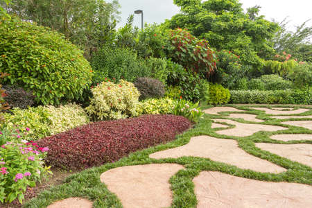 landscaped garden: Landscaped garden with flowerbed and colorful plants