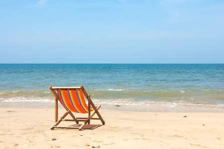 deckchair: Deckchair, chair on the beach in sunshine day.