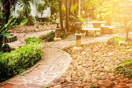 Pathway to residential. Manicured garden design with flare. Stock Photo
