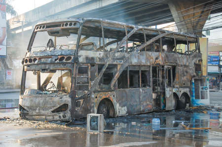 wreckage: 1 December 2013. The bus wreckage violent protests a large antigovernment rally on Rajamangala National Stadium area.Bangkok Thailand