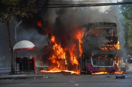 protesters: 1 December 2013. Who burnt bus at Rajamangala National Stadium of among antigovernment protesters  in a december. Bagkok Thailand