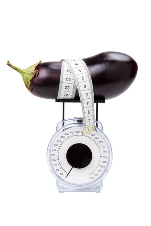 kitchen scale: eggplant with measuring tape on kitchen scale, isolated Stock Photo