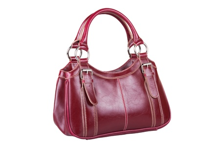womans burgundy handbag, isolated on white