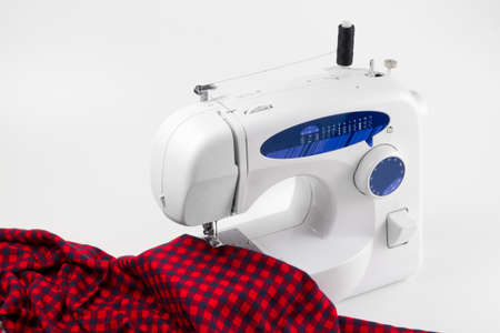 sartorial: sewing machine with red cloth