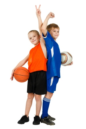 Two boys - a basketball player and football player with balls on white photo