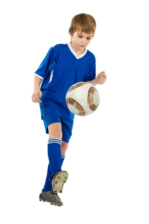 socks child: boy soccer player with ball on white