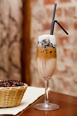latte macchiato: Coffee latte macchiato with coffee beans in basket