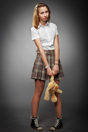 teenager school girl with teddy bear photo