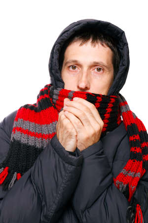 man in winter clothes shivering from the cold on white Stock Photo - 12437722