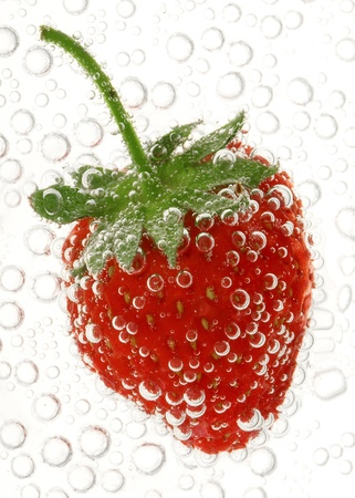 Strawberry in water with bubbles
