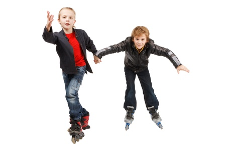 Two happy roller boys, isolated photo