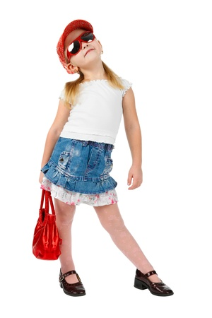 Fashion girl in sunglasses with a red handbag, in catwalk model pose, looking up, isolated on white