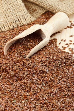 linseed, flax seeds, wooden scoop, sacking bag Stock Photo - 12936271