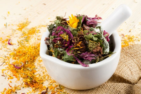 mortar and pestle with healing herbs, herbal medicine Stock Photo - 12936274