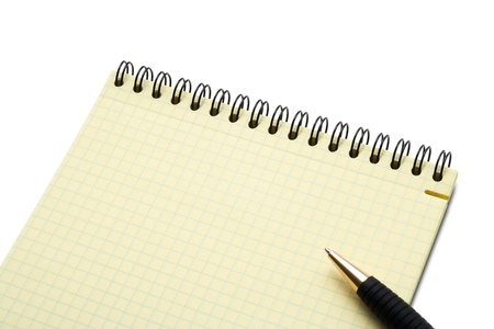 Notebook and pen on white background photo