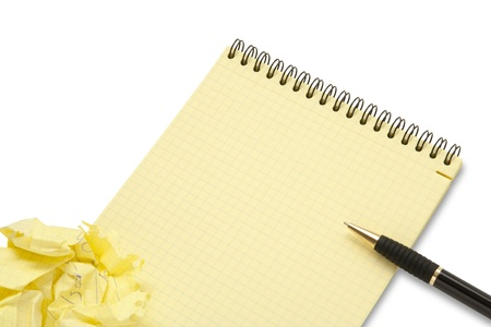 Notebook and crumpled paper wad with pen on white background photo