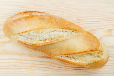 freshly: Freshly baked baguette  on wooden cutting board, top view Stock Photo