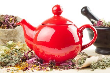 red teapot, mortar and pestle, sack with healing herbs, alternative medicine  photo
