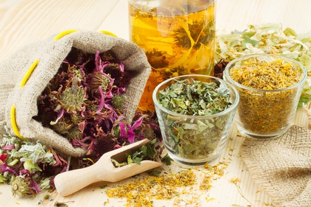 meal preparation: healing herbs and healthy tea on wooden table, herbal medicine Stock Photo