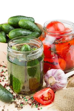 pickled: canned tomatoes and cucumbers, homemade preserved vegetables Stock Photo