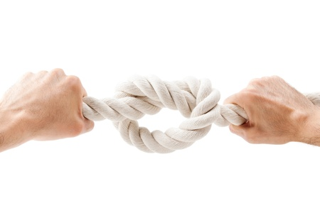 mans hands tied knot on a rope