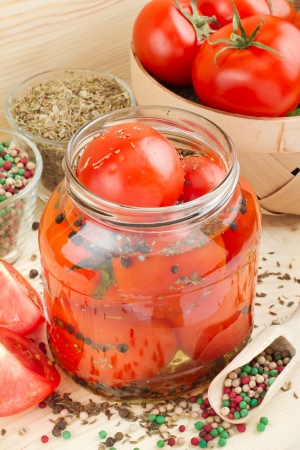 tomato slices: Homemade tomatoes preserves in glass jar  Canned tomatoes