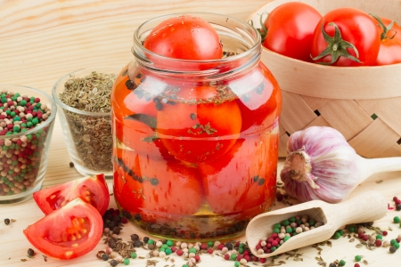 Homemade tomatoes preserves in glass jar  Canned tomatoes   photo