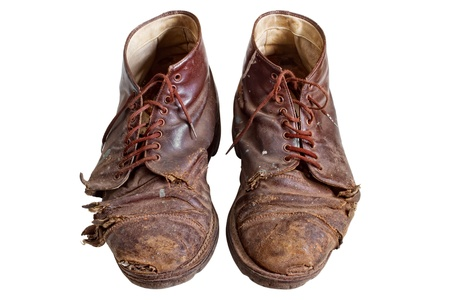 old shoes: Old worn out  boots, isolated on white Stock Photo