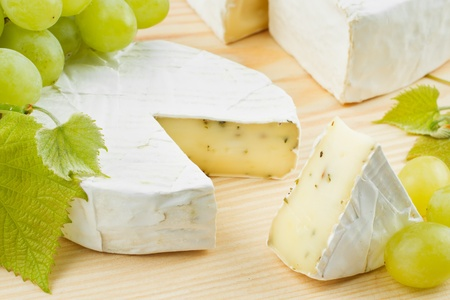 sliced cheese: gourmet cheese and grapes Stock Photo