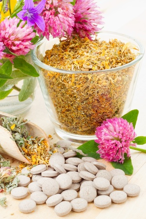 healing herb in glass, tablets, herbal medicine Stock Photo - 14118685