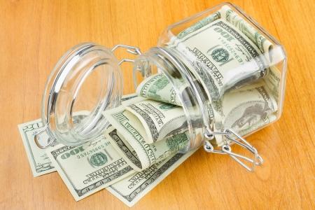 dollars in glass jar