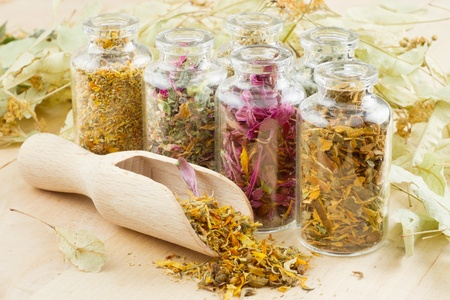 healing herbs in glass bottles, herbal medicine photo