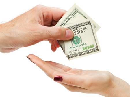 Mans hand giving hundred dollars to female hand, isolated on white photo