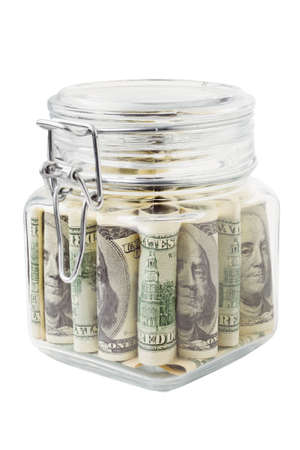 glass jar with dollars, isolated photo