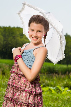 Smiling beautiful girl with umbrella photo