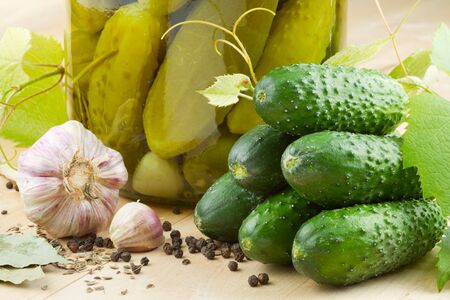 pickled cucumbers, homemade preserved vegetables photo
