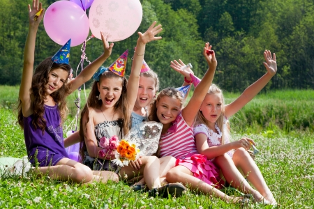 birthday celebration: beautiful girls celebrate birthday in summer park outdoors Stock Photo