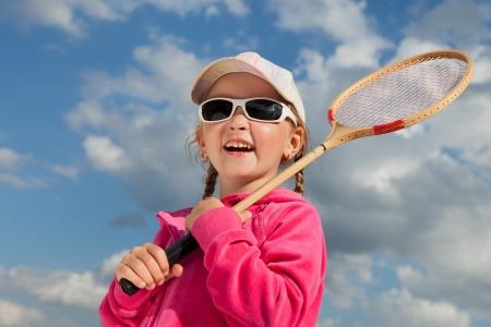 little girl with racket for badminton photo