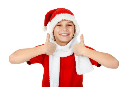 happy boy in Santa Claus hat showing thumbs up, on white photo