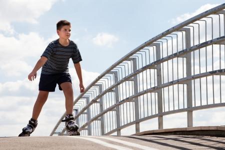 inline skating: boy roller skating  Stock Photo