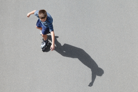 dynamic activity: boy roller skating, top view