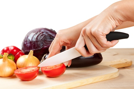knife tomato: ceramic knife with vegetables on cutting board Stock Photo