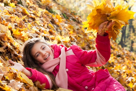 girl with autumn leaves photo