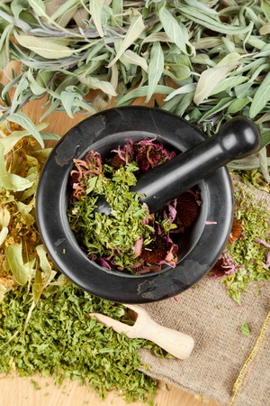 healing herbs on wooden table, mortar and pestle, herbal medicine, top view Stock Photo - 16577744
