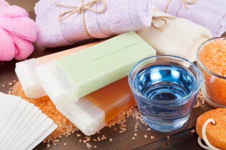 wax: Body care accessories  towels, sea salt, soap, pumice stone and wax for hair removal Stock Photo