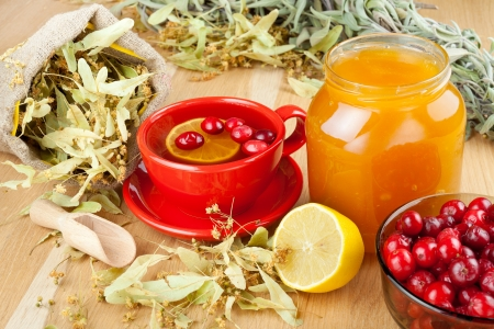 cranberries, jar with honey, fruit tea cup, healing herbs and lemon Stock Photo - 16688836