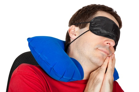 man with travel Neck Pillow and Sleeping mask sleep in a armchair