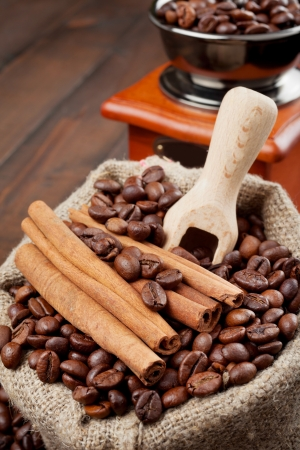sack with coffee beans and coffee grinder  photo